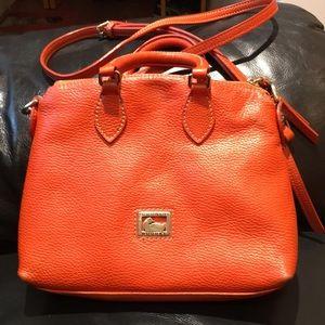 Dooney Bourke orange crossbody bags